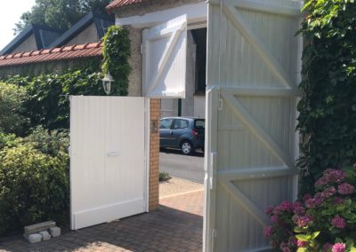 Restauration d'une porte cochère en bois à Bezannes près de Reims